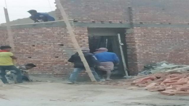 সাপাহারে এলজিইডি'র রাস্তার জায়গা দখল করে অবৈধ স্থাপনা নির্মাণ